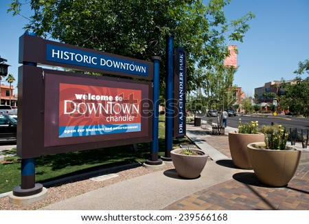 CHANDLER, AZ - APRIL 15, 2012: View of the main road and sign welcoming tourists to Historic Downtown Chandler Arizona, USA.