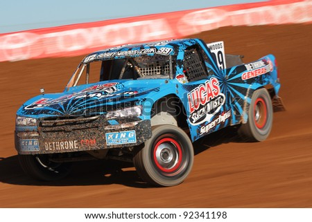 CHANDLER, AZ - DEC 09: Robby Woods (99) at speed in Pro 2 Unlimited Lucas Oil Off Road Series qualifying on Dec. 9, 2011 at Firebird International Raceway in Chandler, AZ. - stock photo