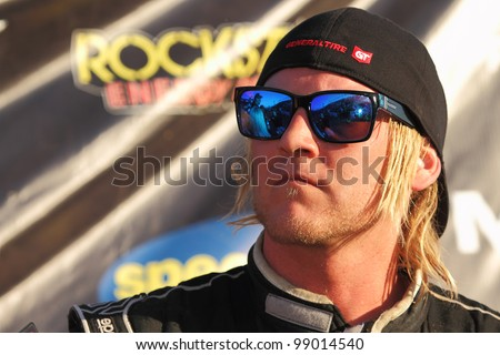 CHANDLER, AZ - MARCH 31: Third place, Robby Woods (99) in Pro 2 Unlimited Lucas Oil Off Road Series Round 1 racing on March 31, 2012 at Firebird International Raceway in Chandler, AZ. - stock photo