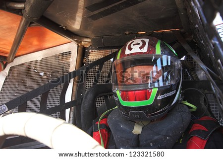 CHANDLER, AZ - OCT 26: Carl Renezeder (1) on the grid in his Pro 4 Unlimited Lucas Oil Off Road Series racing for qualifying on October 26, 2012 at Firebird International Raceway in Chandler, AZ. - stock photo