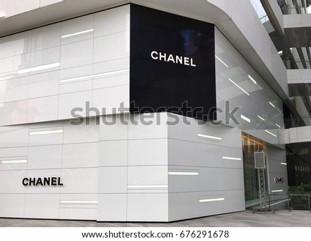 CHANEL logo in front of chanel boutique store outside at the Emquartier department store in Bangkok Thailand 5 July 2017