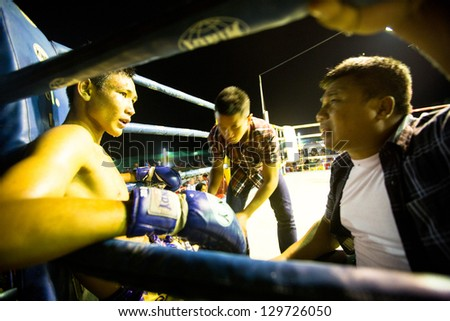 CHANG, THAILAND - FEB 22: Unidentified Muaythai fighter in ring during match, Feb 22, 2013 on Chang, Thailand.For many Thai men, is only way to break out of poverty, per battle pay to 7000 baht. - stock photo