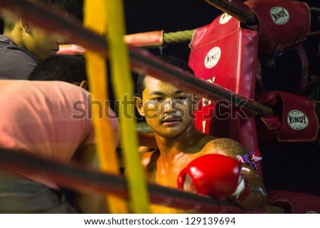 CHANG, THAILAND - FEB 22: Unidentified Muaythai fighter in the ring, Feb 22, 2013 on Chang, Thailand. For many Thai men, Muaythai - only way to break out of poverty, per battle pay 1500 to 7000 baht. - stock photo