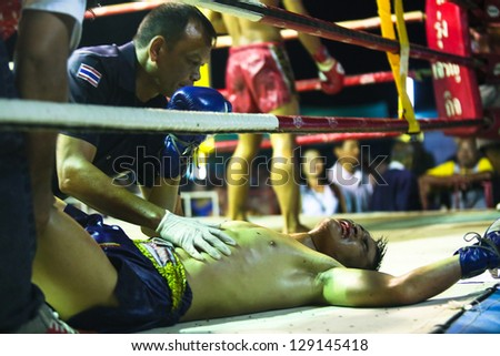 CHANG, THAILAND - FEB 22: Unidentified Muaythai fighters in the ring, Feb 22, 2013 on Chang, Thailand. For many Thai men, Muaythai - only way to break out of poverty, per battle pay 1500 to 7000 baht. - stock photo