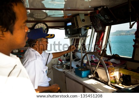 CHANG, THAILAND - JAN 18: Unidentified driver of a ferry to the Chang island, Jan 18, 2013 on Chang, Thailand. A popular tourist destination Chang is 30/18 km is the second largest island of Thailand.