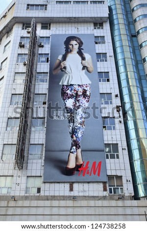 CHANGCHUN-CHINA-OCT. 11. H&M billboard on a flat. The Swedish multinational retail-clothing company opened its 100th Chinese outlet on Sept. 20, 2012 in Nanning. Changchun, Oct. 11, 2012. - stock photo