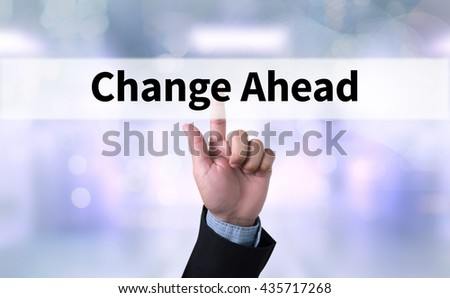 Change Ahead Business man with hand pressing a button on blurred abstract background - stock photo