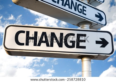 Change direction sign on sky background - stock photo