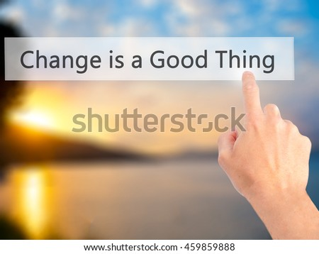Change is a Good Thing - Hand pressing a button on blurred background concept . Business, technology, internet concept. Stock Photo
