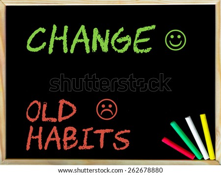 Change Old Habits message with sad and happy emoticon faces.Handwriting with chalk on wooden frame blackboard, colored chalk in the corner. Lifestyle change concept image - stock photo
