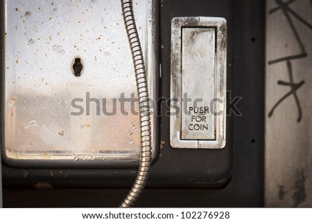 Change slot in an old vandalized payphone. - stock photo