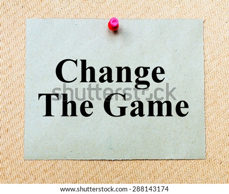Change The Game  written on paper note pinned with red thumbtack on wooden board. Business conceptual Image - stock photo