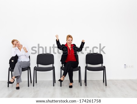 Change your attitude and change your life concept with bored and excited woman on chairs - stock photo