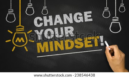 change your mindset on blackboard background - stock photo