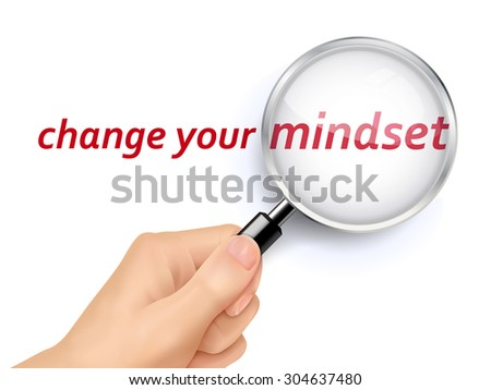 change your mindset showing through magnifying glass held by hand - stock photo