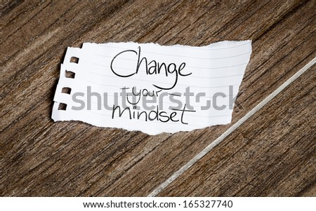 Change your Mindset written on the paper on a wood background - stock photo