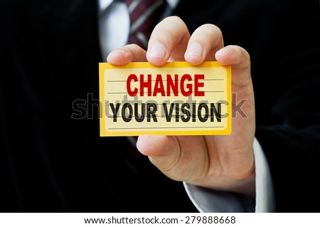 Change Your Vision written on a card in male hand - stock photo