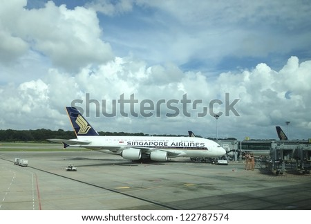 CHANGI AIRPORT, SINGAPORE - DEC 16: A Singapore Airlines Airbus A380 plane at Singapore Changi Airport on December 16, 2012. Singapore Airlines has been one of the largest buyers of Airbus A380. - stock photo