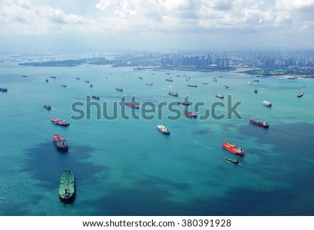 CHANGI, SINGAPORE -21 JAN 2016- Aerial view of the lines of cargo container ships waiting to enter the port of Singapore. - stock photo