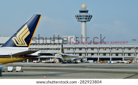 CHANGI, SINGAPORE -14 JANUARY 2014- The logo of a Singapore Airlines (SQ) plane as it gets ready for take-off at Singapore Changi Airport (SIN) with the control tower in the background. - stock photo