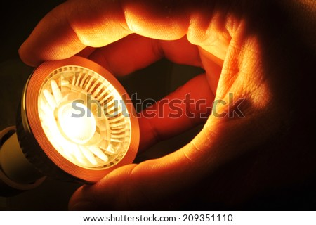 changing a COB-LED at night  - stock photo