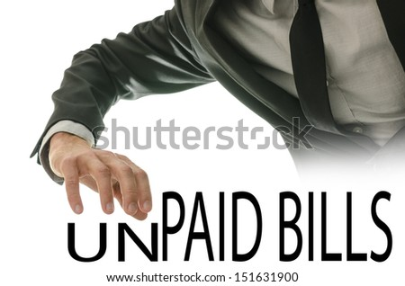 Changing phrase Unpaid bills into Paid bills by crushing letters UN. - stock photo