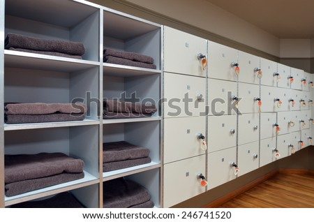 Changing room facility with lockers and clean towels. - stock photo