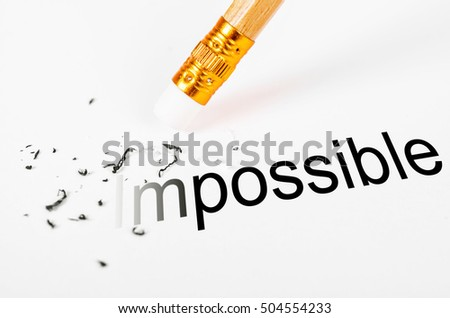 Changing the word impossible to possible with a pencil eraser on white paper.