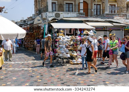 CHANIA, CRETE, GREECE - AUGUST 2015: Tourists at central trading square of Chania town on Crete island, Greece