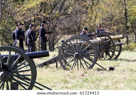 CHANNAHON, IL - OCTOBER 17: Soldiers load and discharge cannons in the Civil War Days Reenactment on October 17, 2010 in Channahon, IL