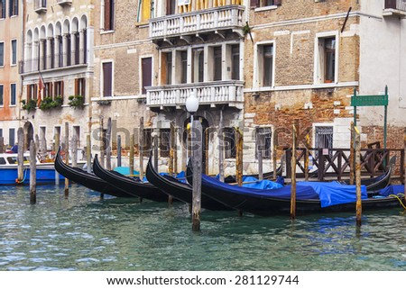 channel (Canal Grande). Gondolas at pier. The grand channel is the main transport artery and its most known channel