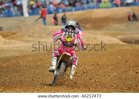 CHANTABURI, THAILAND - FEB 7:Unidentified rider in action at Thailand motocross championship 2010 first round on February 7, 2010 in Chantaburi, Thailand.