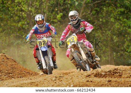 CHANTABURI, THAILAND - FEB 7:Unidentified riders in action at Thailand motocross championship 2010 first round on February 7, 2010 in Chantaburi, Thailand.