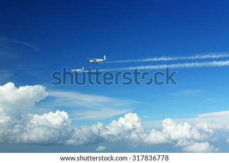 CHANTHABURI, THAILAND - APRIL 6, 2012: Plane artificial rain using chemicals to scattering plane in sky that caused rain to water shortage and agriculture, King was creating artificial rainmaking   - stock photo