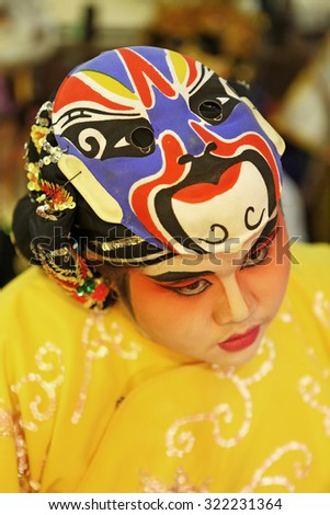 CHANTHABURI, THAILAND - Oct 1: Unidentified Chinese opera male and female actors painting face at backstage on October 1, 2011 in Chanthaburi. It is vegetarianism on Sep - Oct of the annual - stock photo
