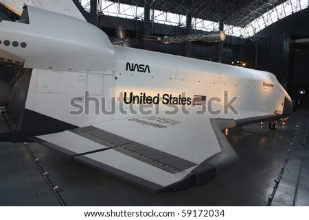 CHANTILLY, VIRGINIA - AUGUST 15: Space Shuttle Enterprise at the National Air and Space Museum's Steven F. Udvar-Hazy Center.   Taken August 15, 2007 in Chantilly, Virginia. - stock photo