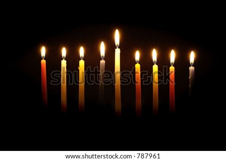 Chanuka candles lit for the eighth night. - stock photo