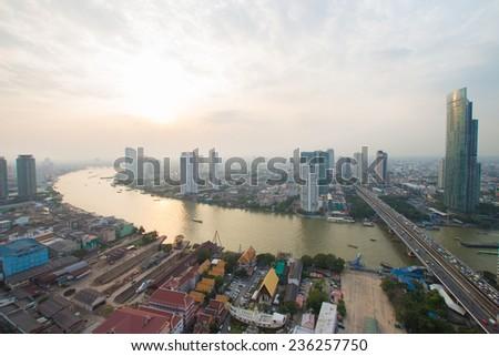 Chao Phraya river and city scape in Bangkok, Thailand - stock photo