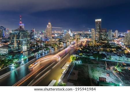 Chaophraya river and Bangkok cityscape at night - stock photo