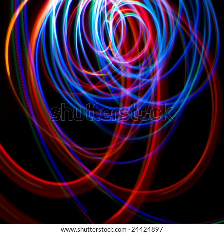 Chaotic colorful lights on a black background - stock photo