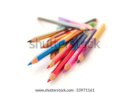 Chaotic heap of color pencils on a white background - stock photo