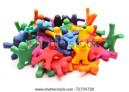 chaotic heap of many different colorful plasticine people