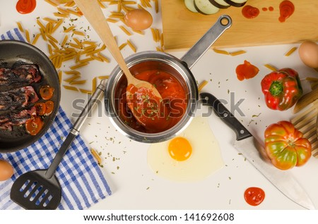 Chaotic kitchen table left by some untidy cook - stock photo