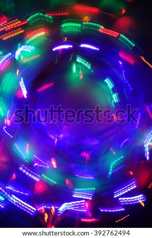 Chaotic lights in moriol blur out of focus - abstract photograph background.
