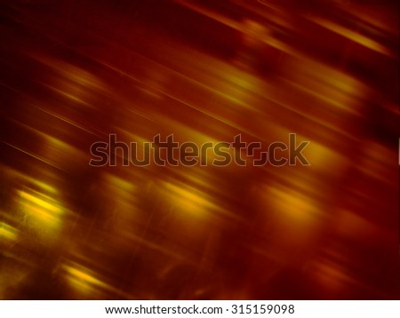 Chaotic texture with a retro mood. Abstract background in grunge design. The structure looks like a crumpled skin or veins wood. Warm, and cozy autumn colors. Blurred background effects haze grainy.