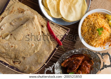 Chapati or Flat bread, roti canai, Indian food, made from wheat flour dough. Roti canai and curry.  - stock photo