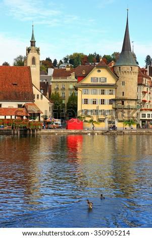 Chapel Bridge and riverfron in Lucerne, Switzerland - stock photo