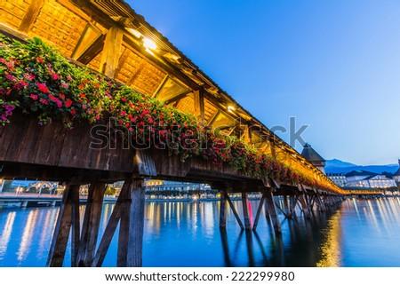 Chapel bridge at night in Lucerne, Switzerland - stock photo