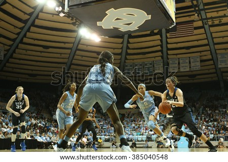 CHAPEL HILL, NC-FEB 28: Duke Blue Devils guard Rebecca Greenwell (23) drives to the basket against the University of North Carolina Tar Heels on February 28, 2016 at Carmichael Arena. - stock photo