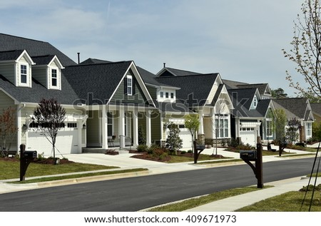 Chapel Hill, North Carolina - April 19, 2016:  Newly built contemporary homes line a street at the Briar Chapel residential Village